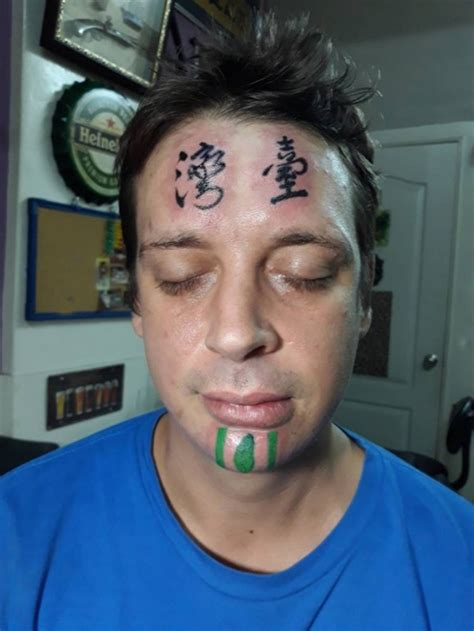 forehead tattoo gets forehead saying taiwan in