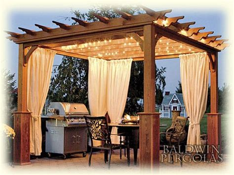 I adore this pergola i like the lighting and the curtains all that s missing is a brick over