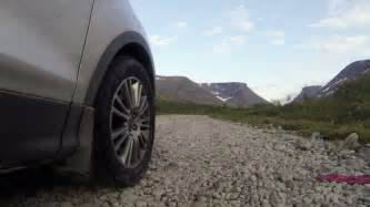Truck Tires On A Gravel Road Laughing Car Driving Across Mountain River Tire On