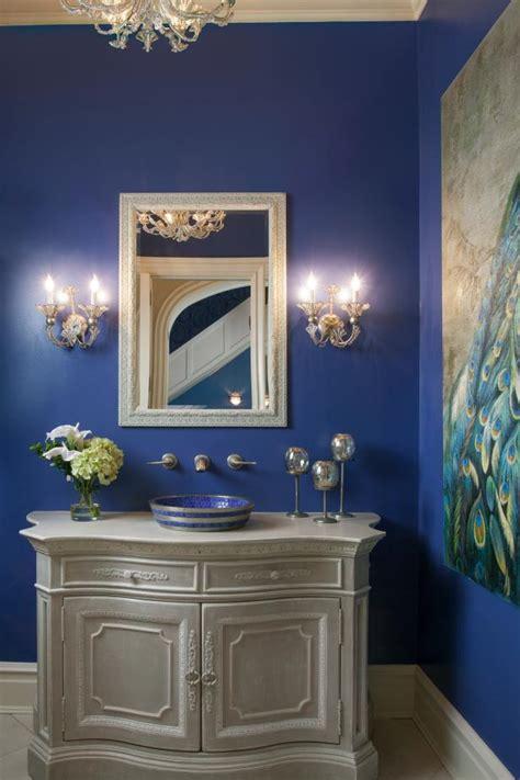 bright blue traditional powder room  chandelier hgtv