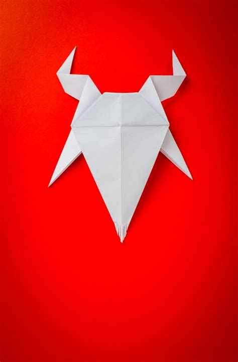 Origami Goat - origami paper goat on background new year of the goat