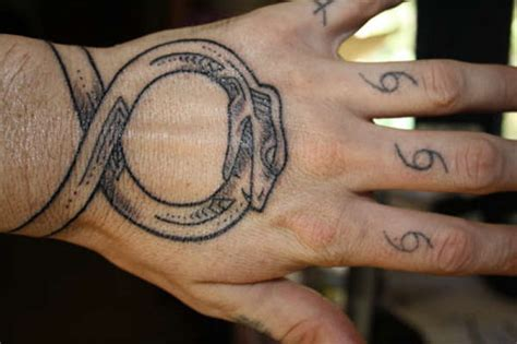 ouroboros tattoo wrist 25 breathtaking ouroboros designs creativefan