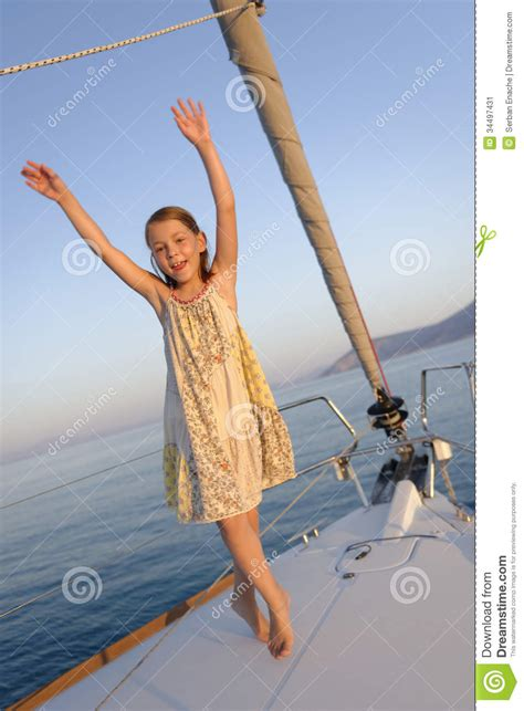 girl dancing on boat with kid girl on sailboat deck stock image image of maritime