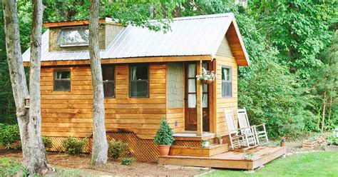married couple s wind river bungalow tiny home tiny cedar bungalow s clever storage options make it as