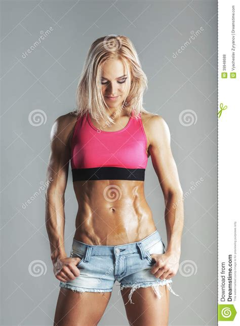 beautiful young sporty muscular woman    abs