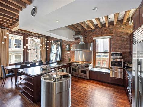 cozy  york city loft enthralls   eclectic interior wrapped  brick