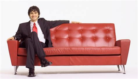 man on the couch corporate housing housing helpers