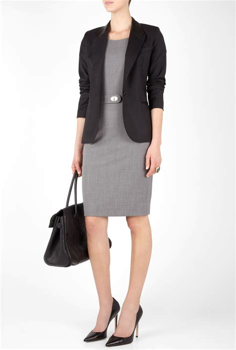 womens professional wear a business dress paired with a fitted black blazer is a