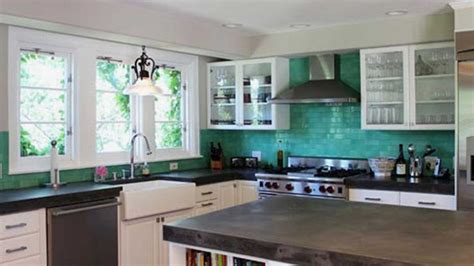 kitchen cabinetry subway tiles and teal kitchen on