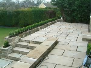 raised patio area for entertaining olive garden design and landscaping