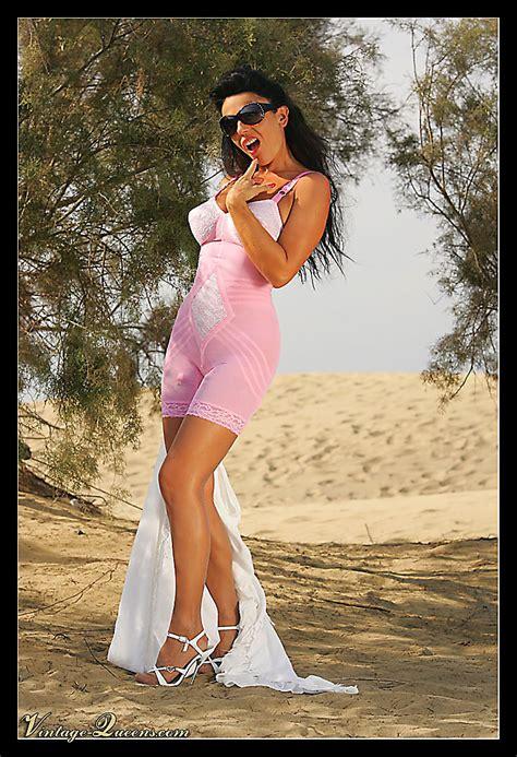 vintagequeens eve posing   countryside wearing high heels sheer shiny stockings  long pink