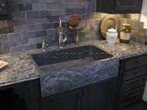 this charcoal grey granite sink has a rockface apron and a
