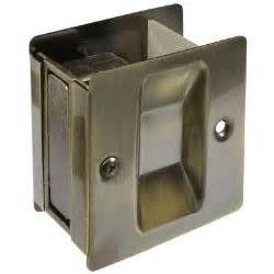 national hardware antique brass pocket door pull v1950