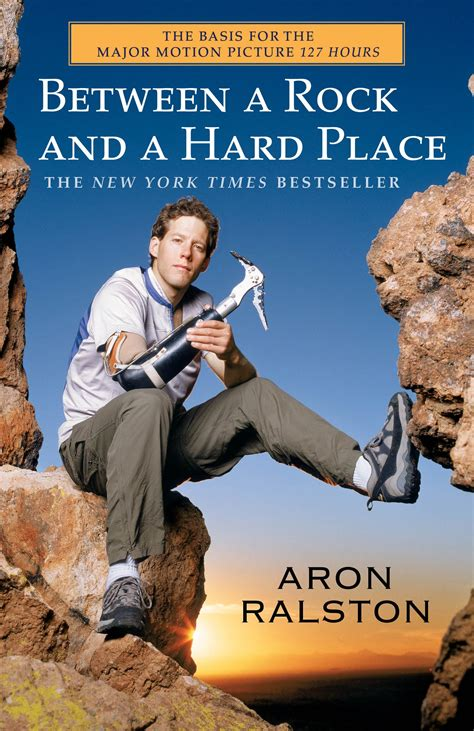 in between the two books between a rock and a place book by aron ralston