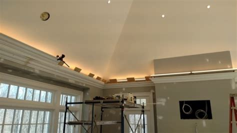 Put Together Kitchen Cabinets pro install led lighting behind flying crown molding