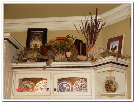 kitchen decorations for above cabinets 5 charming ideas for above kitchen cabinet decor home