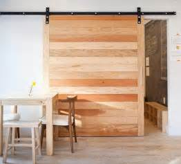 Sliding Wood Barn Doors Reclaim Your Home 14 Solid Reclaimed Wood Ideas For Your Abode Brit Co