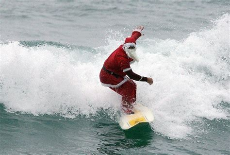 santa on surfboard langland bay santa surfing santa laundry service