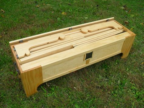 lada wood portatile it looks like a bench but it turns into a bed in a box