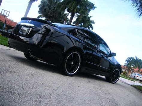 blacked out nissan altima ride or die