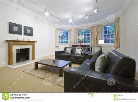 Credit On Sofas Living Room With Large Bay Window Stock Photography