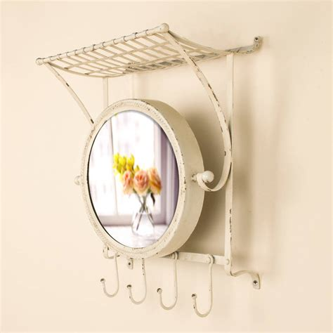 Wall Mirror With Hooks And Shelf by Wall Shelf With Hooks And Oval Mirror By Dibor