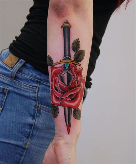 dagger and rose tattoo black iron clean custom tattoos in northern ontario