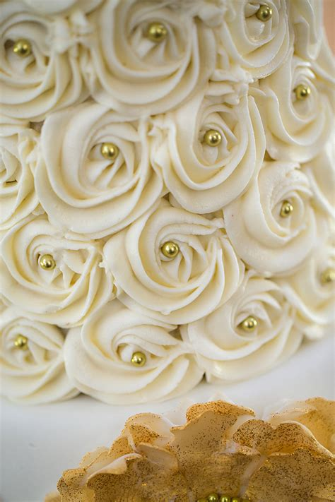 pics   week ivory  gold rosette cake