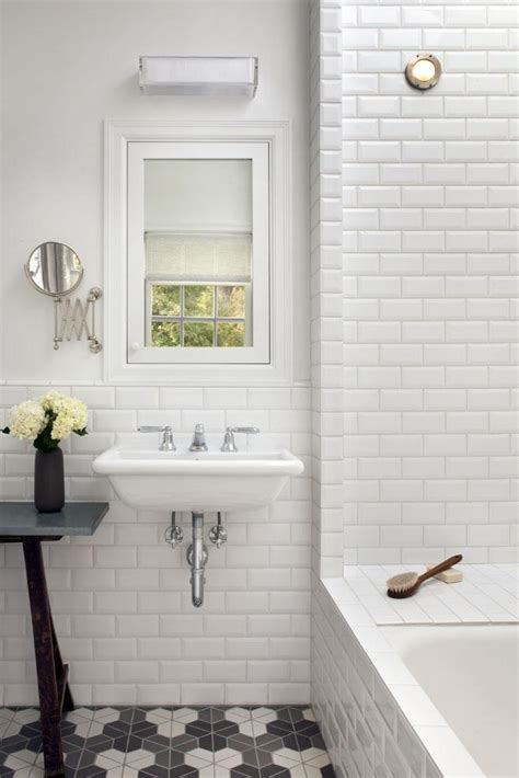 white beveled subway tiles gray hex floor tiles wall mounted sink mark reilly remodelista