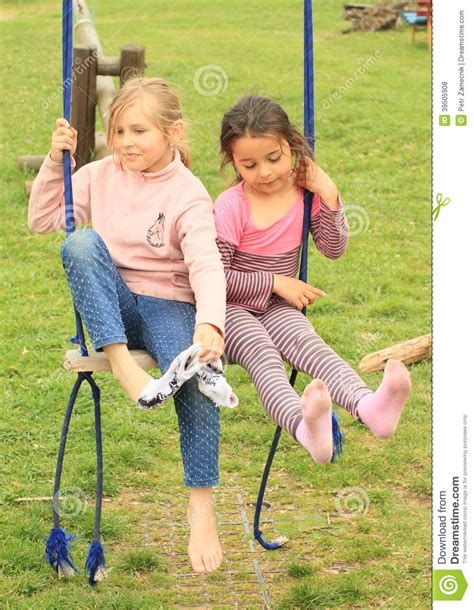 dirty swing two girls on swing stock photo image of sadness sister