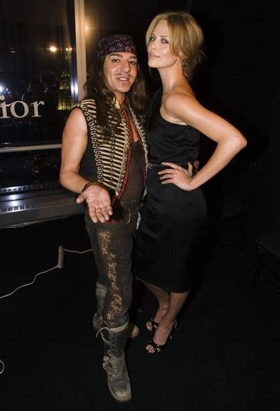 Galliano Gets Smoochy At Diors Cruise Show by Charlize Theron And Galliano Photos Photos
