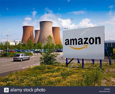 amazon uk sign outside the entrance to amazon uk warehouse in