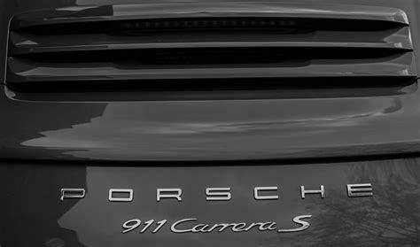 porsche usa emblem porsche 911 carrera s emblem photograph by claire doherty