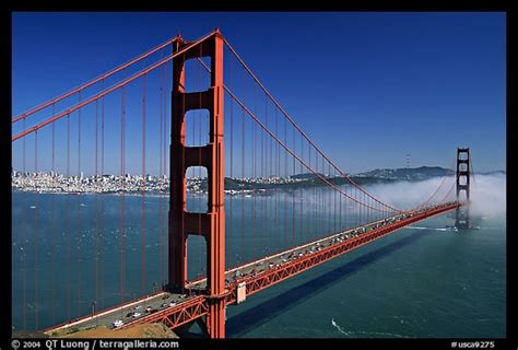 what color is the golden gate bridge picture photo golden gate bridge and fog seen from