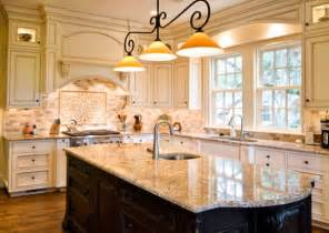 lights with traditional touch above glazed marble kitchen island alita champagne pendants over the look more like