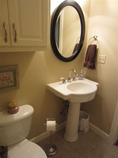 small oval bathroom mirrors oval mirror over pedestal sink bathroom ideas