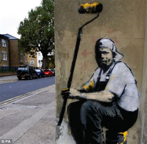 council paints  street artist banksys graffiti