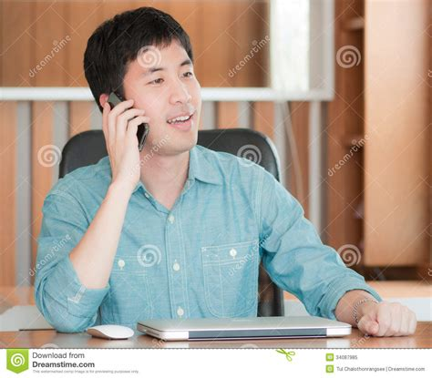 asian using mobile phone royalty free stock photo