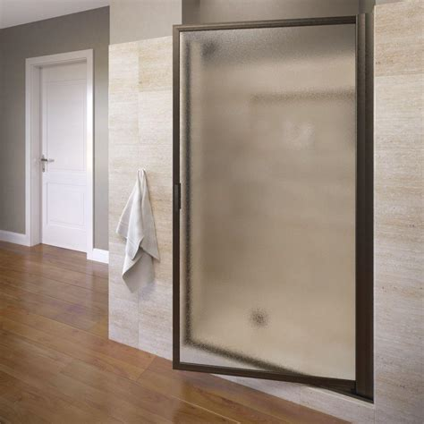 Bronze Shower Doors Basco Deluxe 34 7 8 In X 67 In Framed Pivot Shower Door In Rubbed Bronze 200 8or The