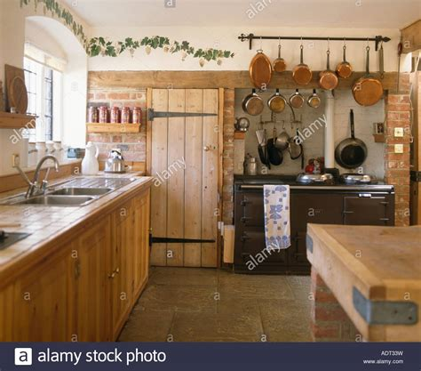 wooden cottage kitchen cottage kitchen with copper saucepans above black aga and