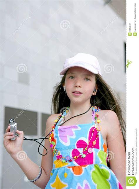 small teen brunette teen little girl dancing mp3 stock photo image 9913572