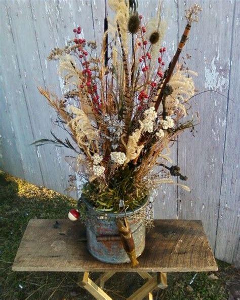 minnow bucket dried flower arrangement flower