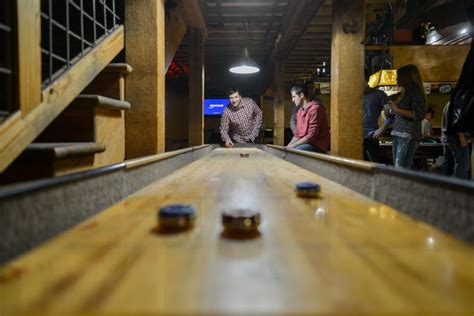 how to play table shuffleboard how to play table shuffleboard on family