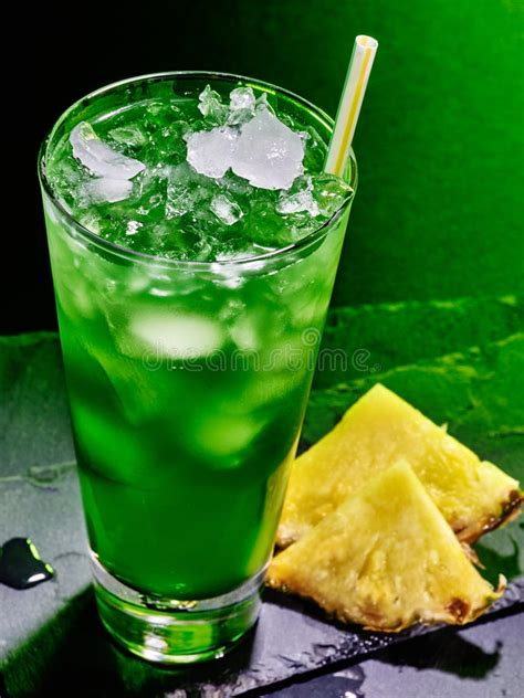 green cocktail black background green pineapple cocktail on dark background 51 stock photo
