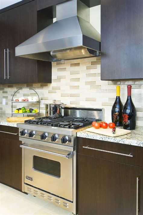backsplash with cherry cabinets grey granite counter