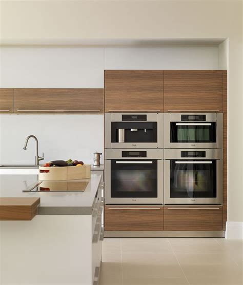contemporary white and wood kitchen block of miele