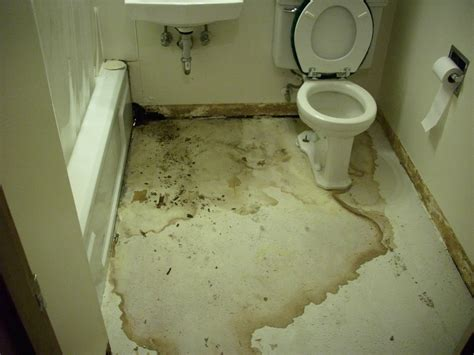bathroom floor leaking bathroom water damage restoration services