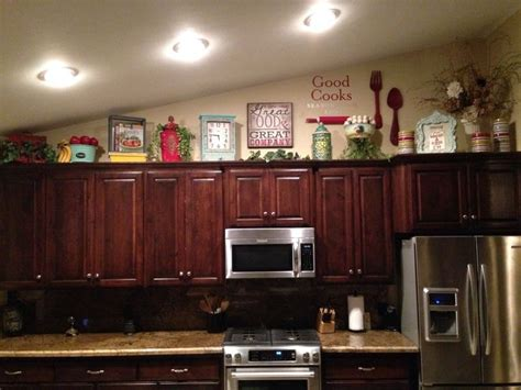 decorations on top of kitchen cabinets above kitchen cabinet decor home decor ideas pinterest