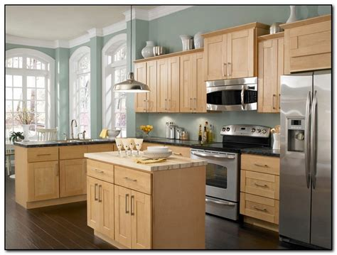 kitchen with light wood cabinets employing light color theme in kitchen cabinets design