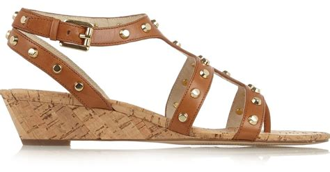 Michael Kors Jollie Gesper michael michael kors studded leather wedge sandals in brown lyst